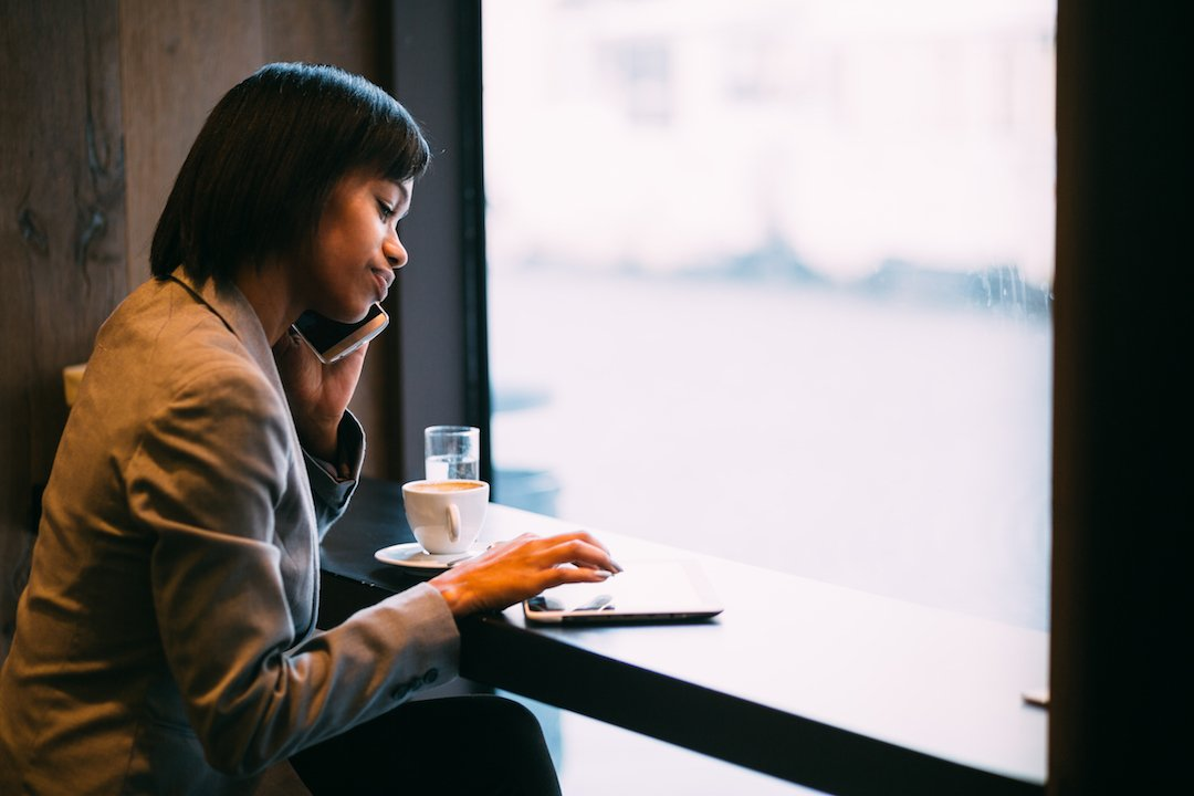 IQTalent Partners employee recruiting passive candidates in a coffee shop